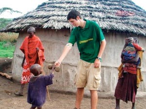 Conor Farese plays with Tupapa Maasai and his brother Papai, a family he got to know while working in Monduli Juu, Tanzania. While in Tanzania, Farese taught English and helped construct a school in the village. – Courtesy of Conor Farese
