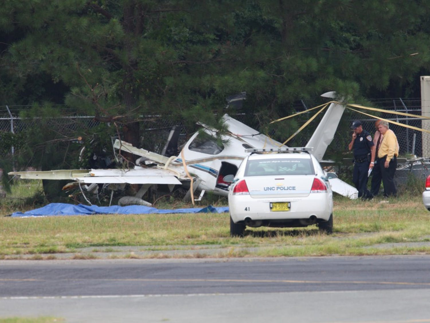 Police investigate a plane crashed at the Horace Williams airport Monday.