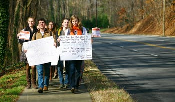 UNC-Chapel Hill students, led by Joseph Terrell (left) and Elizabeth McCain (right), march from the Pit to the Board of Governor's meeting in protest of tuition hikes.