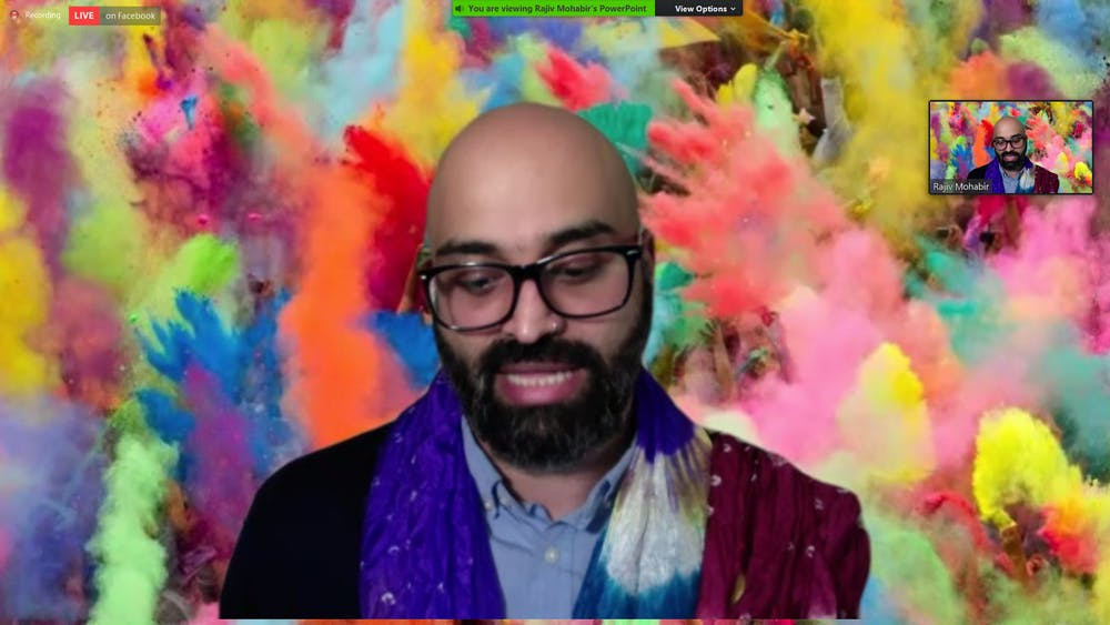 Poet Rajiv Mohabir speaks at an event on Wednesday, March 24, 2021, hosted by the UNC Asian American Center in celebration of Holi.