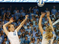 Senior middle hitter Christine Vaughen goes up for a kill against the Miami Hurricanes. Vaughen recorded five kills on seven attempts during the first set. The Tar Heels will face Wake Forest and Duke later this week.