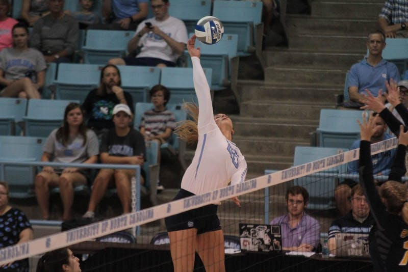 Ava Bell (20) spikes against UNC-Greensboro in Carmichael Arena Friday, Aug. 31.