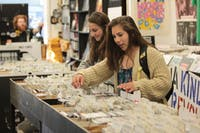 Liz Zarzar and Lydia English browse through records at Schoolkids Records in Chapel Hill.