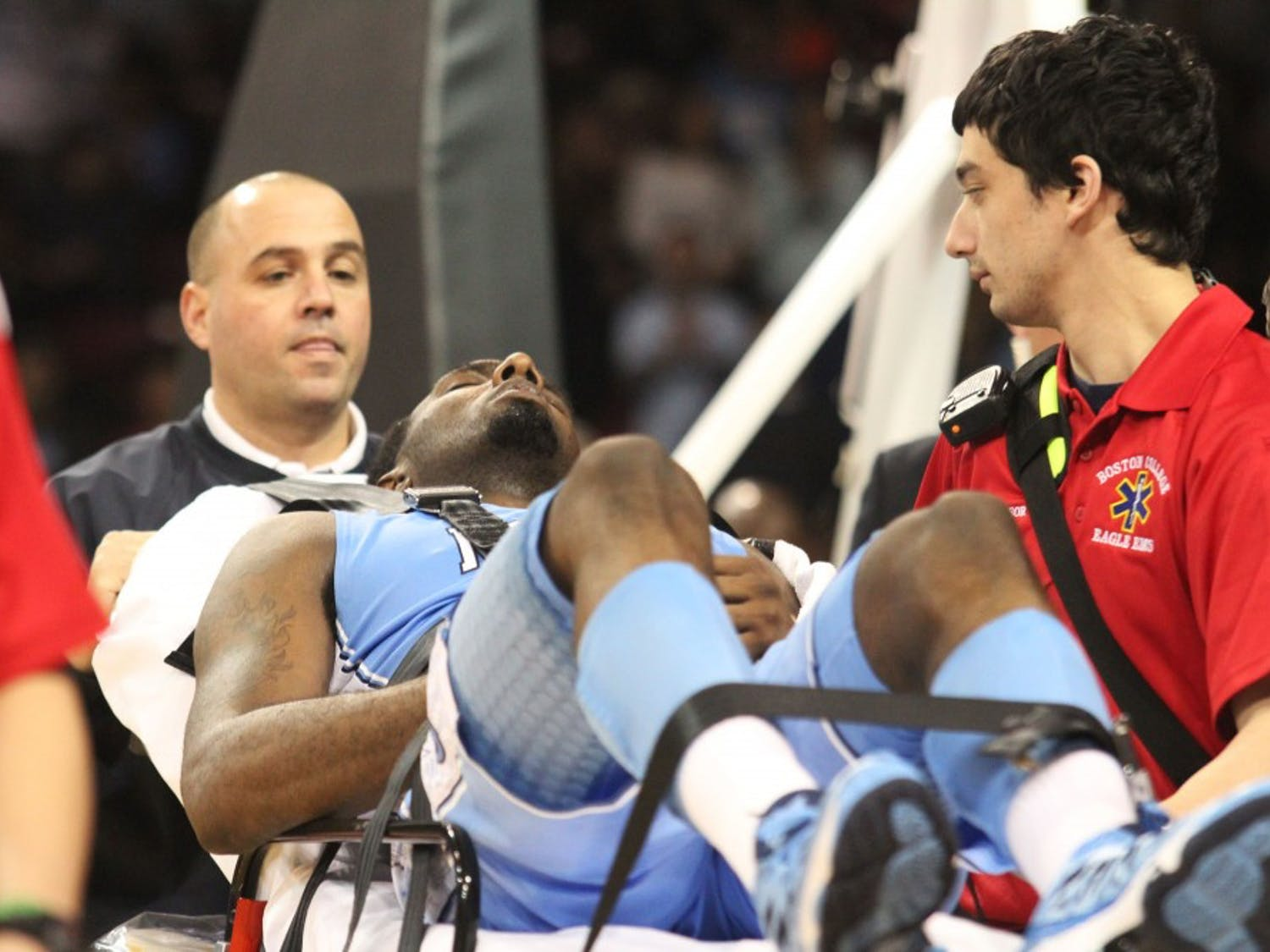 Hairston is carted off the court in a stretcher after his collision with Strickland.