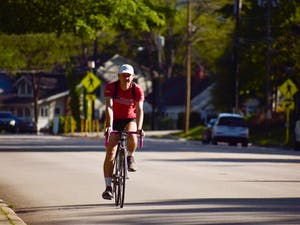 Chapel Hill residents ride their bikes on the highway as they travel from downtown to surrounding neighborhoods.