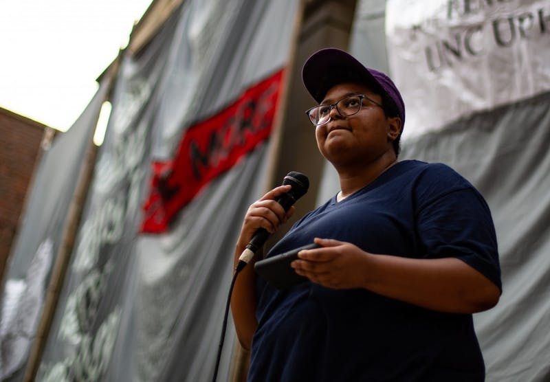 Maya Little speaks at the Peace and Justice Plaza on Monday August 21st against confederate monument Silent Sam. Maya had been previously arrested for her demonstrations against Silent Sam.