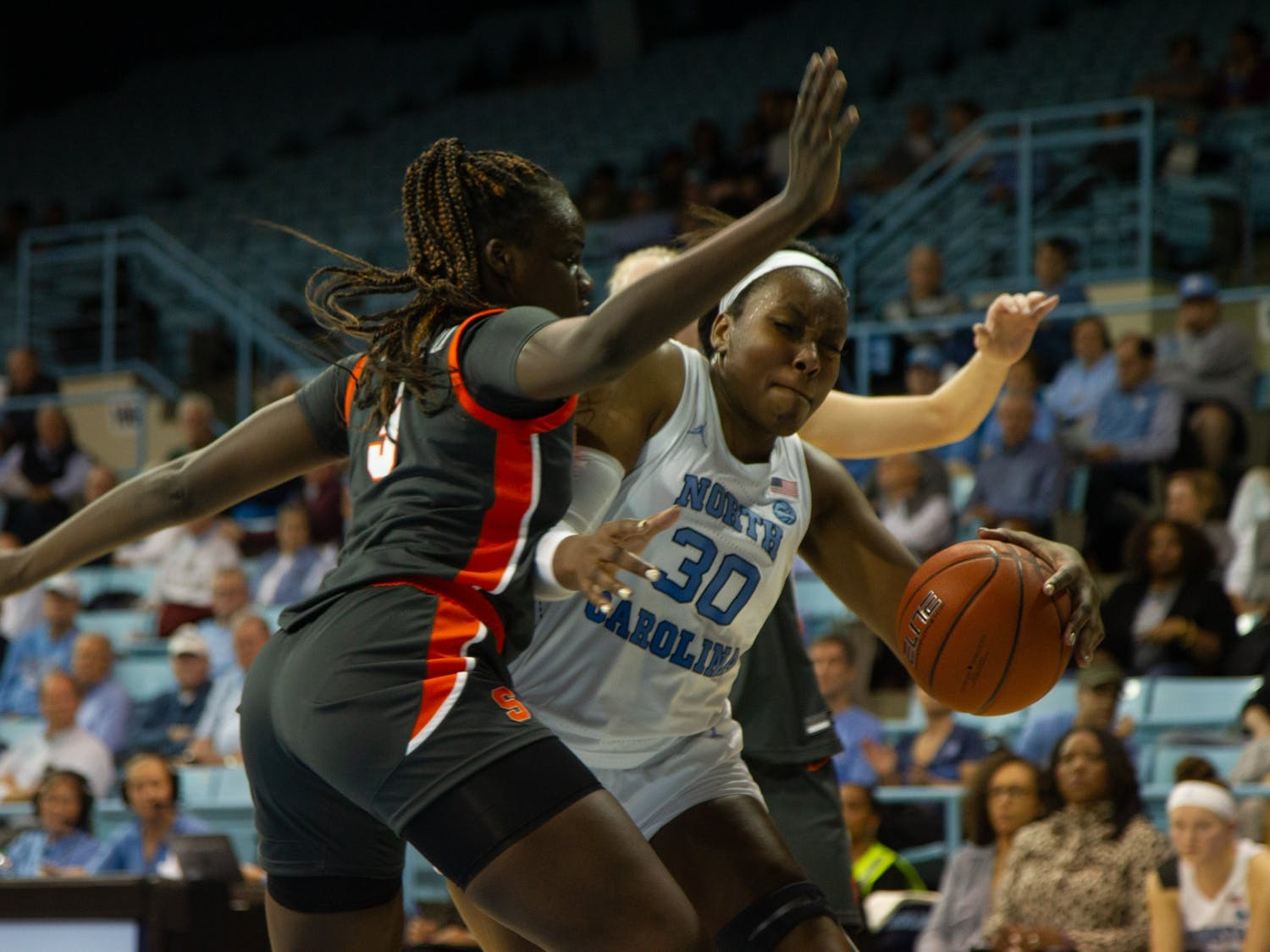 UNC junior center Janelle Bailley (30) goes in for a layup as Syracuse redshirt sophomore forward Maeva Djaldi-Tabdi (3) defends during a game in Carmichael Arena on Thurday, Feb. 13, 2020. Syracuse beat the Tarheels 74-56.