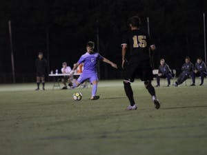 Midfielder Cam Lindley (6) takes a shot against James Madison on Tuesday night at WakeMed Soccer Park in Cary.