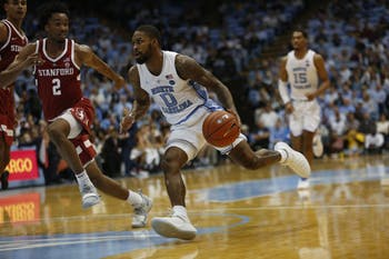 Seventh Woods (0) dribbles in Monday's 90-72 win over Stanford.