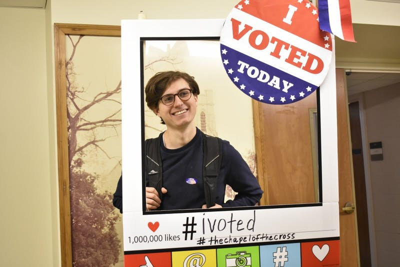 English and religious studies major Josh Pontillo poses for a picture after casting his vote at the Chapel of the Cross church at 304 E. Franklin St. on Oct. 23, 2018. The Chapel of the Cross severs as an early voter location close to the University of North Carolina at Chapel Hill's campus.