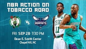 Kemba Walker (15) suits up for the Charlotte Hornets against Kyrie Irving (11) and the Boston Celtics on Sept. 28 in a preseason game at the Smith Center. Photo courtesy of the Charlotte Hornets.
