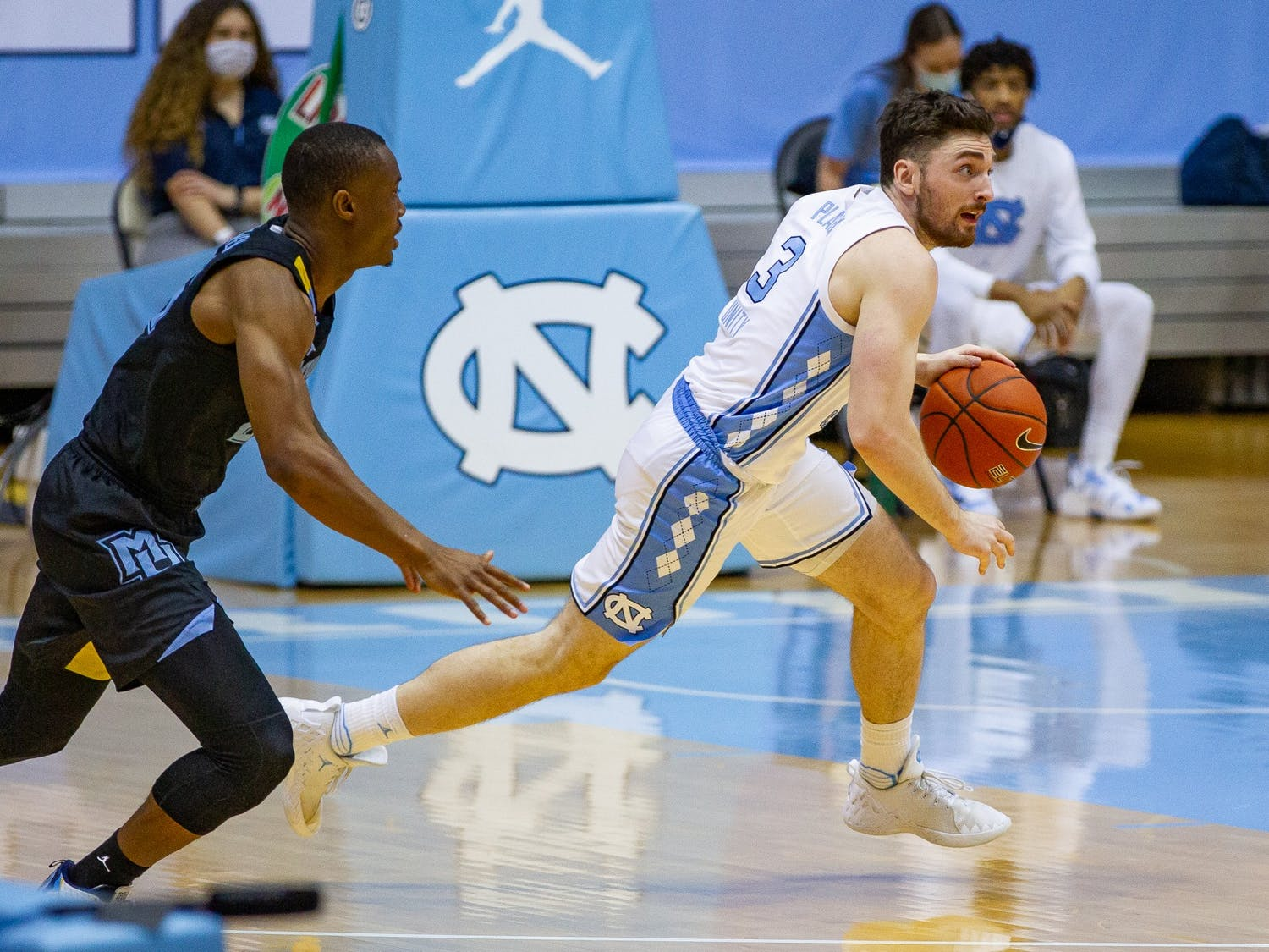 UNC senior guard Andrew Platek (3) dribbles down court during a game against Marquette in the Smith Center on Wednesday, Feb. 24, 202. UNC lost to Marquette 83-70.