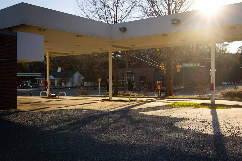 <p>The Chapel Hill Town Council will vote on a project that would redevelop the nonoperational Marathon Service Station and the Tar Heel Mobile Home Park into a new gas station, storage building, and convenience store. The Marathon Service Station is pictured on Saturday, March 6th, 2021.</p>