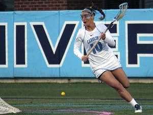 Women's lacrosse suffers a loss 7-6 to Duke in overtime on Wednesday in Kenan Stadium. No. 10 attacker Sydney Holman looks for an opening to score.