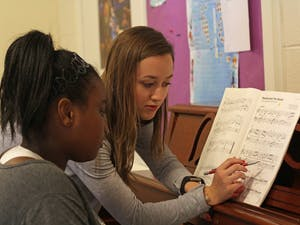 Marissa Cranford teaches piano to Taniya Rogers at the University United Methodist Church on Franklin Street in March of 2017 through the Musical Empowerment program.