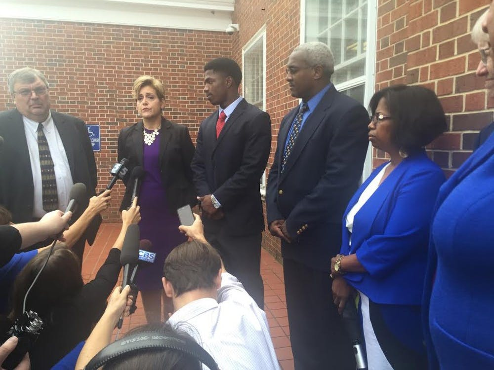 <p>Allen Artis, surrounded by his lawyer and parents, speaks to the media after his court appearance.&nbsp;</p>