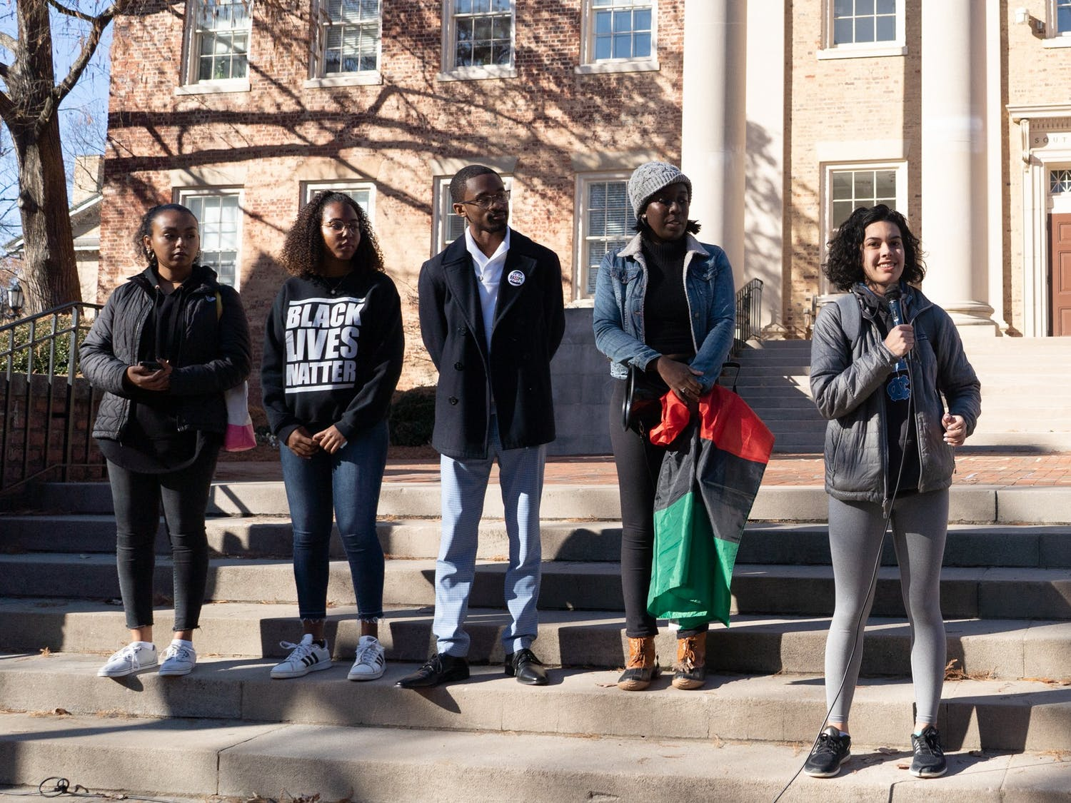 Student Body President Ashton Martin speaks on the steps of South Building on Thursday, Dec. 5, 2019.  The Black Student Movement, Black Congress and local and student activists protested the University giving 2.5 million dollars to the Sons of Confederate Veterans, which were also given Silent Sam, the Confederate monument torn down by activists on the first day of classes in 2018.