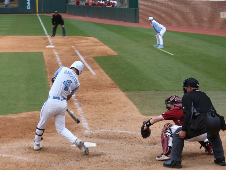 Junior Brandon Martorano (4) swings at bat during the Tar Heels' third baseball game against Boston College on Easter weekend, 2019.