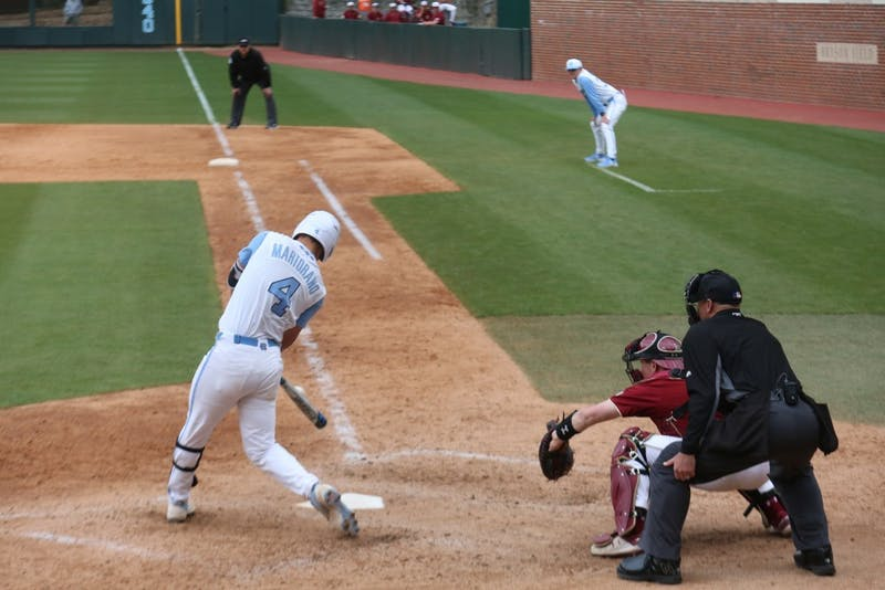 Junior Brandon Martorano (4) swings at bat during the Tar Heels' third baseball game against Boston College on Easter weekend, 2019.
