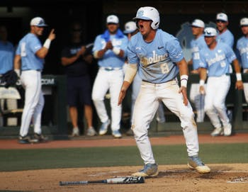 UNC baseball junior and short stop, Ike Freeman (8), celebrates after scoring a run during the final game in the regional championships versus Tennessee on Sunday June 2, 2019. UNC won 5-2.