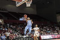 Redshirt senior guard Paris Kea (22) performs a layup during the Tar Heel's 100-69 season opener win against Elon University at the Schar Center in Elon, North Carolina Tuesday, Nov. 6, 2018.