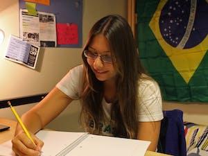 UNC exchange student Rafaela Granzotti, from Brasil, studyies in her dorm room in Aycock.