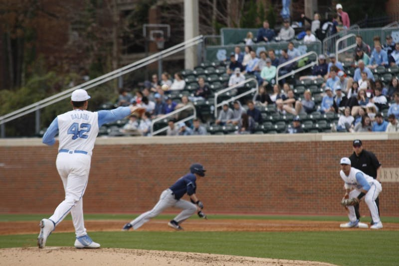 Junior pitcher Gianluca Dalatri (42) throws the ball to first-year first baseman Aaron Sabato (19) during UNC's 12-3 win against Xavier on Friday, Feb. 15, 2019.