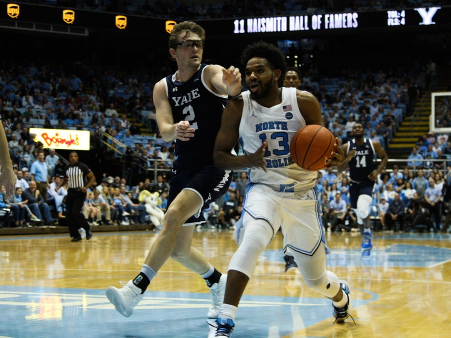First-year guard Jeremiah Francis (13) fight Yale's defense during the game in the Smith Center on  Monday, Dec. 30, 2019.