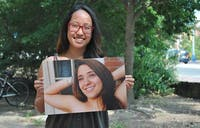Sheena Ozaki, Project Dinah chair, holds a photo of Andrea Pino outside the Union. Pino created the Courage Project, a display in the Union basement that includes pictures and stories from those who have been affected by sexual and interpersonal violence.