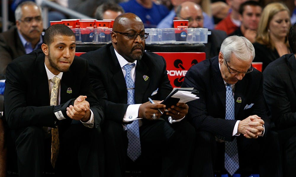 UNC guard Kendall Marshall, assistant coach Steve Robinson and head coach Roy Williams watch nervously from the bench as time winds down. The Tar Heels defeated Ohio 73-65 in overtime at the Edward Jones Dome in St. Louis on Friday in the Sweet 16 round of the NCAA Tournament.