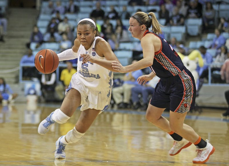 Sophomore guard Stephanie Watts (5) drives towards the basket.