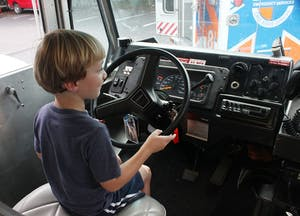 Denali Cutbush-Taylor, 4, pretends to drive one of the EMS vehicles at the South Orange Rescue Squad open house on Sunday.