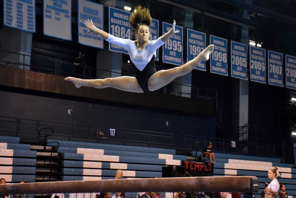 <p>Alexis Allen competes in the beam routine a Jan. 19 meet against Temple in Carmichael Arena.&nbsp;</p>