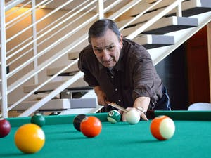 Orange County senior Joe Acciarito shoots pool at the Robert and Pearl Seymour Center in Chapel Hill, which he visits six times a week.