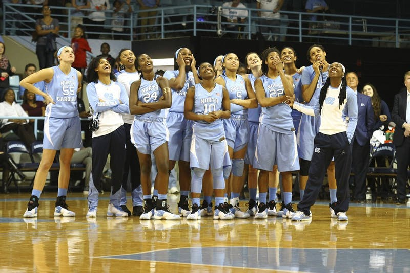 The Tar Heels watch a video in honor of senior night after they lost to Duke 93-57.