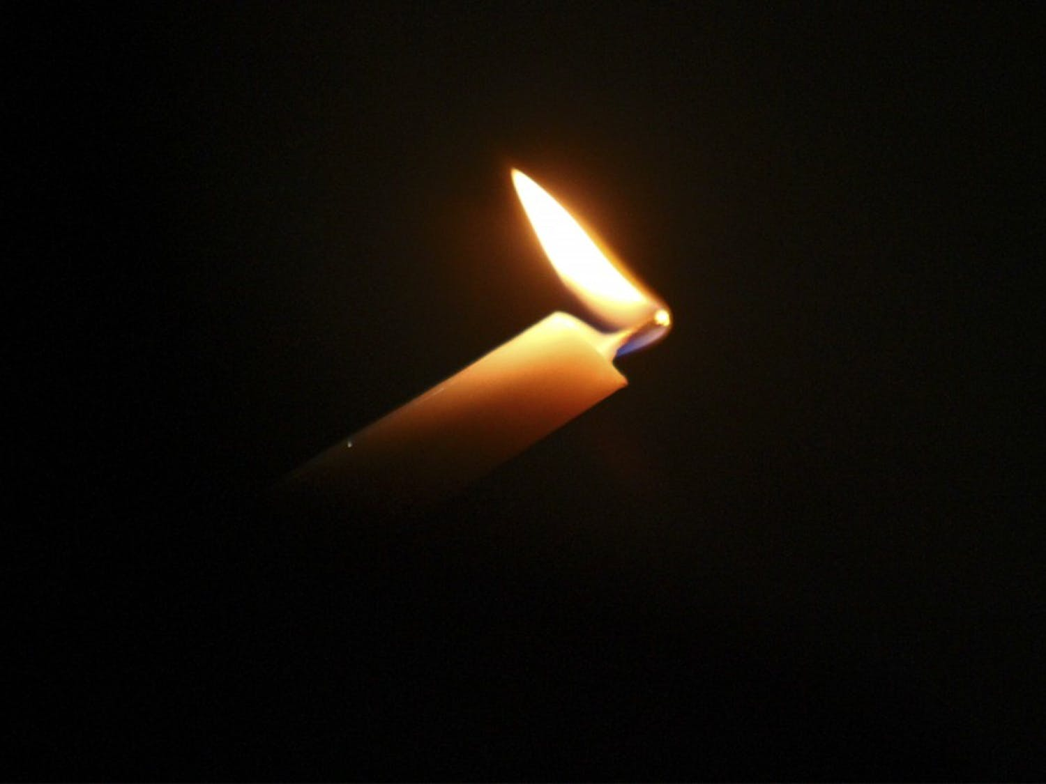 A candlelight vigil in the Pit remembered Deah Shaddy Barakat, Tusor Mohammed Abu-Salha and Razan Mohammed Abu-Salha on Wednesday.