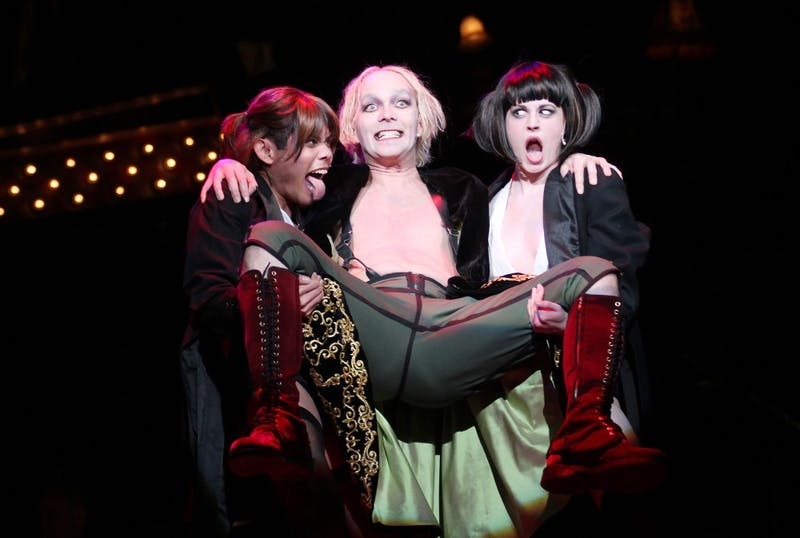 """Taylor Mac, center, performs the role of the Emcee in Playmaker's """"Cabaret."""" He performed a section of his work, """"The 1780s,"""" on Monday."""