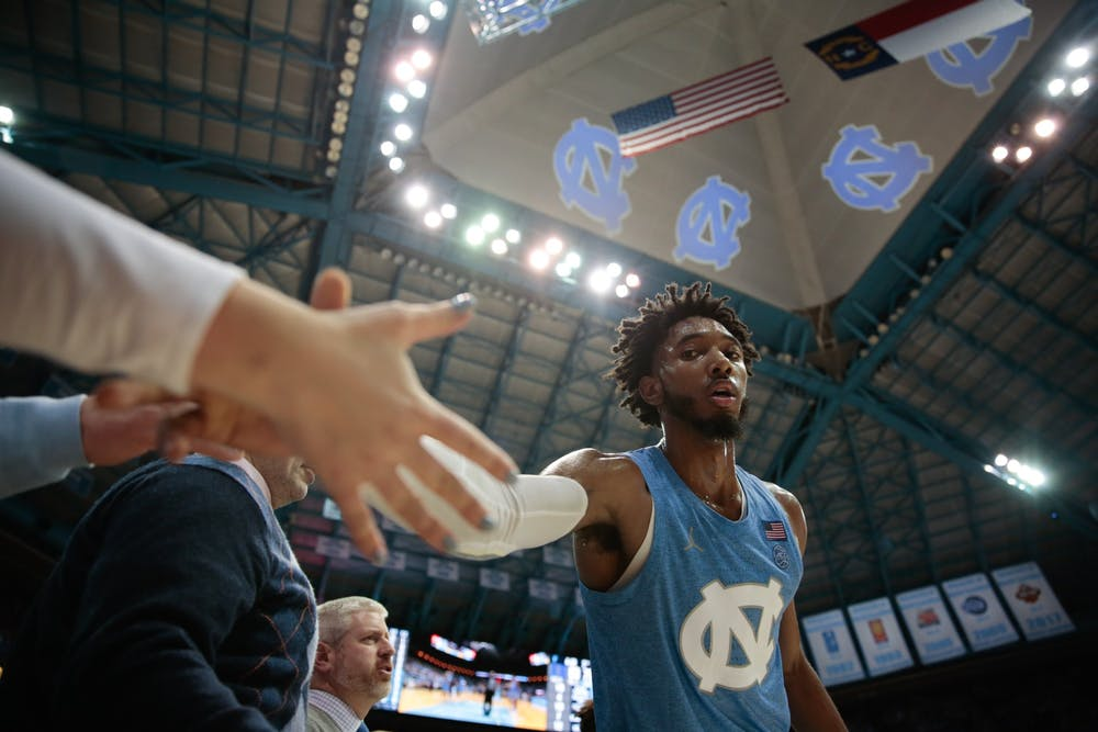 UNC sophomore guard Leaky Black high-fives down the bench during a game against Duke in the Smith Center on Saturday, Feb. 8, 2020. The Tar Heels lost to the Blue Devils 98-96.