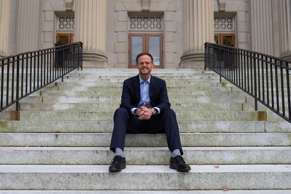 <p>Andy Jenks poses for a portrait on the steps of Wilson Library on Sept. 21.&nbsp;</p>
