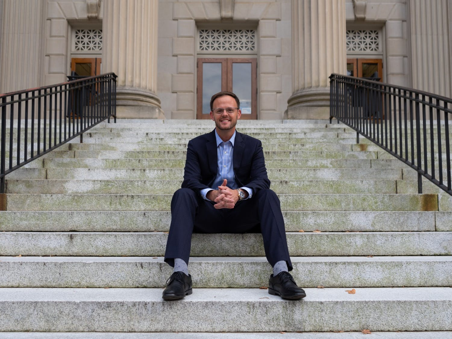 Andy Jenks poses for a portrait on the steps of Wilson Library on Sept. 21.
