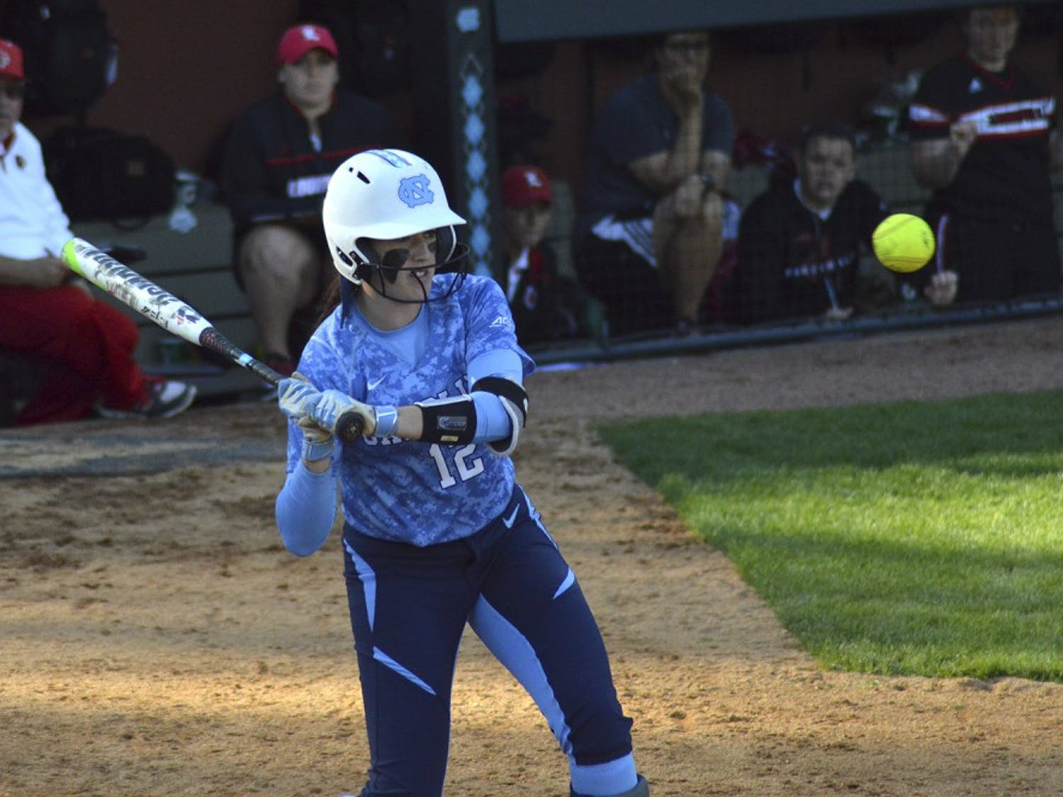 Shortstop Kristen Brown swings at the ball during UNC's game against Louisville on Saturday.