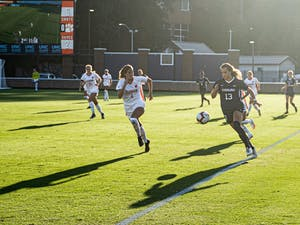 UNC sophomore forward Isabel Cox (13) dribbles the ball upfield during the game against Clemson at Dorrance Field on Thursday, Oct. 1, 2020. UNC beat Clemson 2-0.