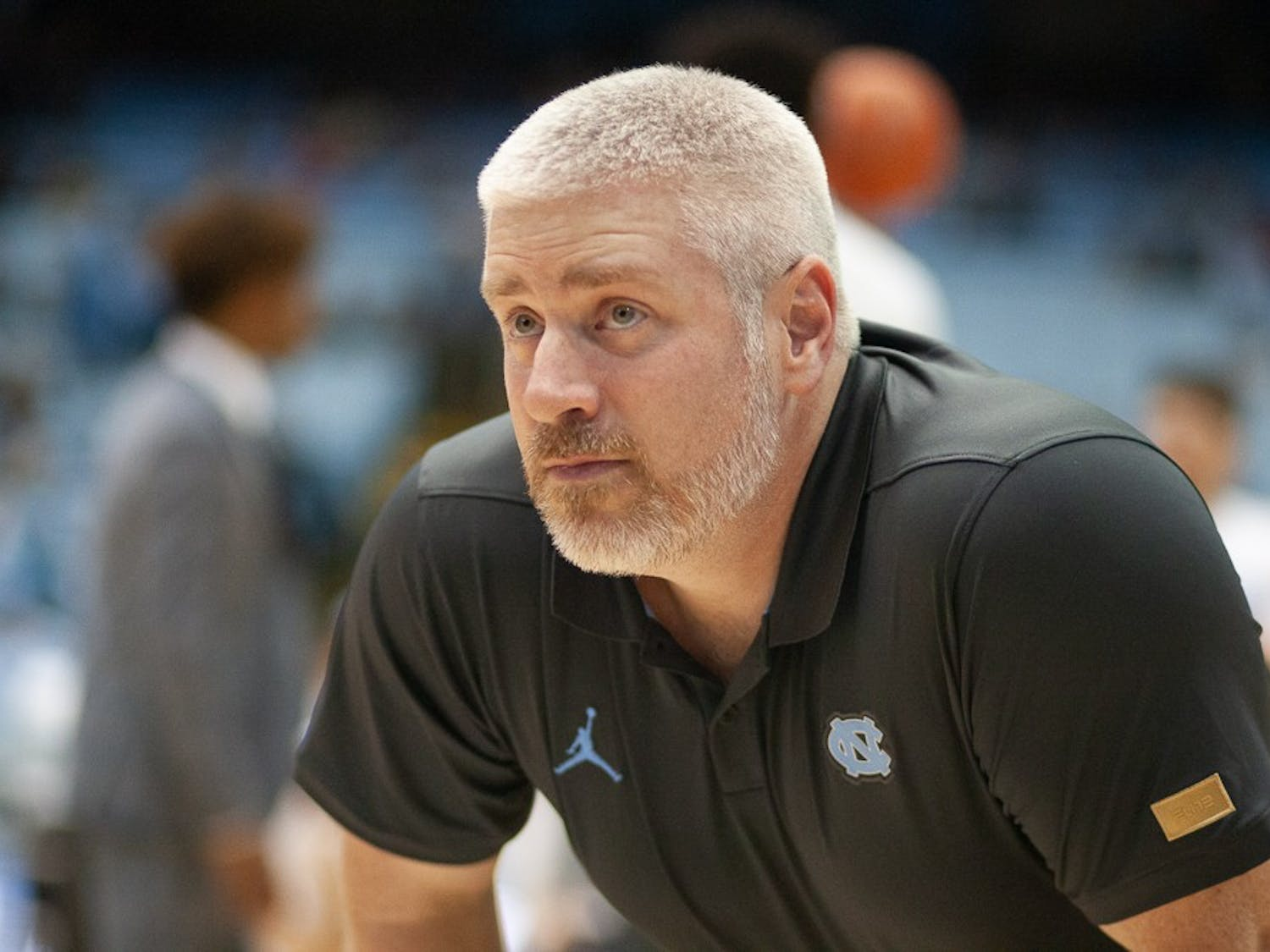 UNC men's basketball head athletic trainer Doug Halverson works before a game against N.C. State in the Smith Center on Tuesday, Feb. 25, 2020.