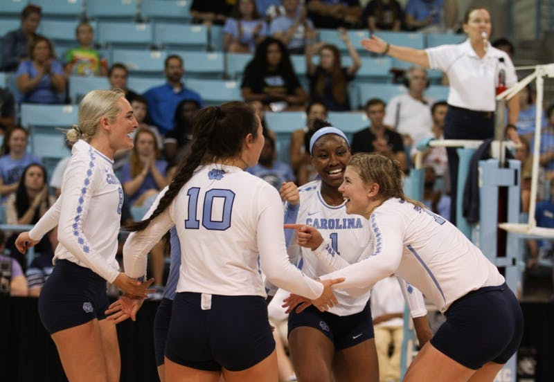 UNC volleyball celebrates a point during the game against UNC-Greensboro Friday in Carmichael Arena.