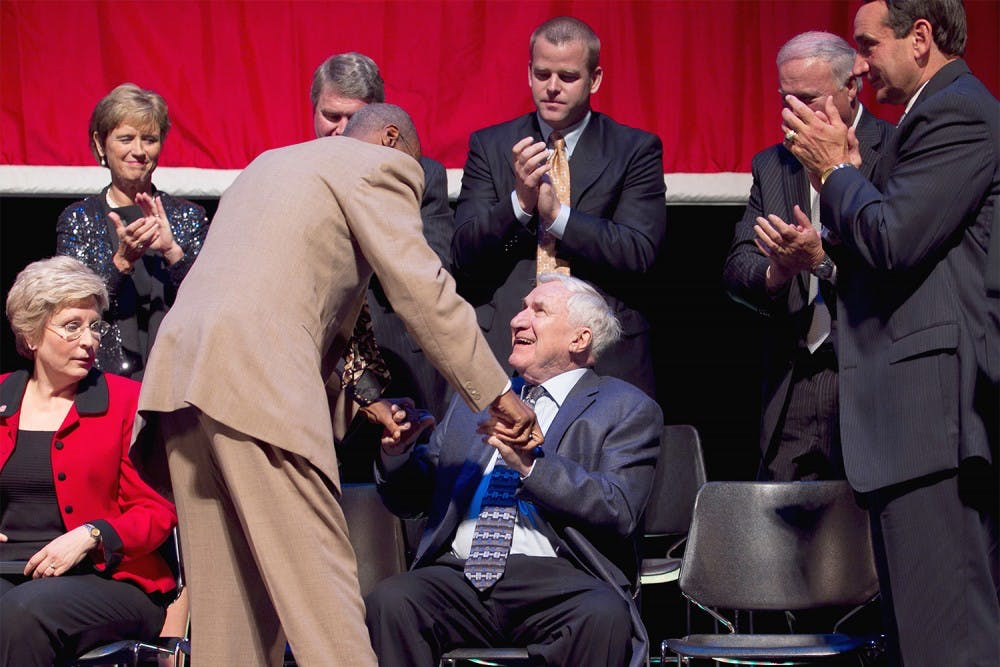 Charlie Scott embraces former North Carolina coach Dean Smith, who was honored with the Dr. James A. Naismith Good Sportsmanship Award Wednesday, June 29, 2011 at Memorial Auditorium in Raleigh, North Carolina. (Robert Willett/Raleigh News & Observer/MCT)