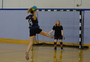 UNC senior Chandler Musson, a goalie for the women's handball team, prepares to defend the net from a shot by a teammate during practice.