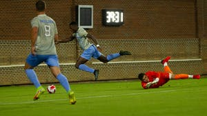 UNC senior midfielder and defender Milo Garvanian (22) successfully scores a penalty against Loyola Marymount on October 19, 2021 at Dorrance Field. The Tar Heels' defeated the Lions 2-0.