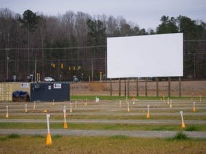 The large screen overlooks parking spots at The Drive-In at Carraway Village on Wednesday, Feb. 10, 2021. The Drive-In features classic movies and special series from Film Fest 919.