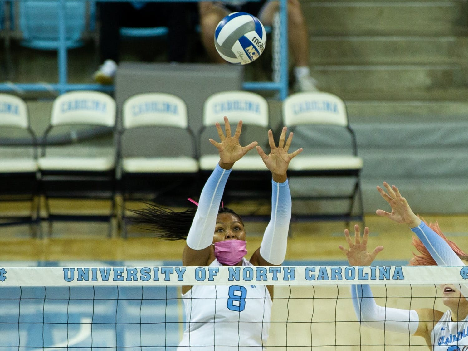 Junior middle blocker Skyy Howard (8) blocks the ball at the volleyball game against  Duke on Oct. 22 at Carmicahel Arena. UNC won 3-0.