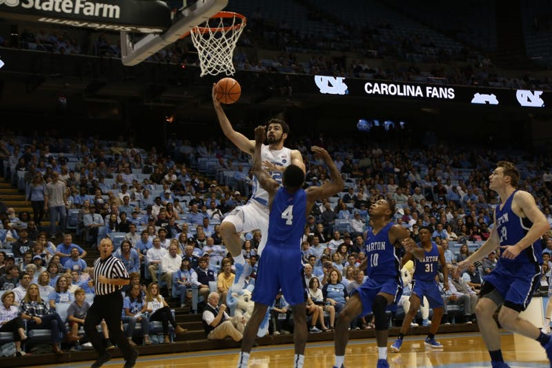 Forward Luke Maye (32) goes up for a shot against Barton College on Friday in the Smith Center.
